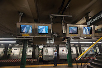 Monitors mounted to enable the conductor to view out of visibility sections of a subway train in a station are seen  in the New York subway on Saturday, September 27, 2014. (© Richard B. Levine)