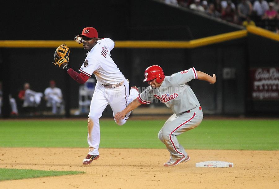 May 5, 2008; Phoenix, AZ, USA; Arizona Diamondbacks second baseman Orlando Hudson (left) fails to make the out at second base as Philadelphia Phillies base runner Shane Victorino breaks up the play at Chase Field. Mandatory Credit: Mark J. Rebilas-