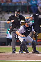 Home plate umpire Harrison Silverman calls a batter out on strikes as Bowling Green Hot Rods catcher Chris Betts (26) starts towards the dugout during the game against the Dayton Dragons at Fifth Third Field on June 8, 2018 in Dayton, Ohio. The Hot Rods defeated the Dragons 11-4.  (Brian Westerholt/Four Seam Images)