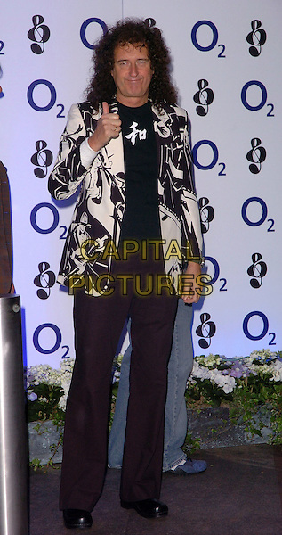 BRIAN MAY.At the O2 Silver Clef Awards, Hilton Park Lane, London, Englnd, June 16th 2006..full length thumb up gesture funny black and white jacket patterned prtint.Ref: CAN.www.capitalpictures.com.sales@capitalpictures.com.©Can Nguyen/Capital Pictures