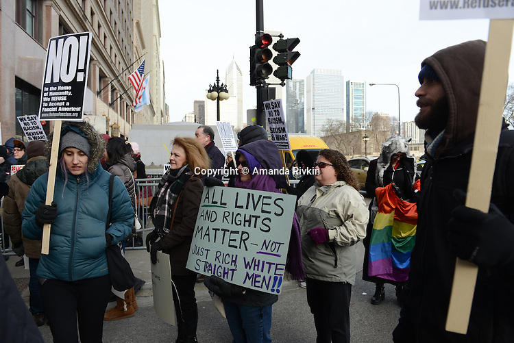Protesters demonstrate against Vice-President Elect Mike Pence outside the Chicago Club as Pence attended a fundraiser luncheon with supporters where tickets cost $2,700 in Chicago, Illinois on December 30, 2016.