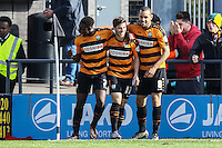 Luke Gambin of Barnet (centre) celebrates scoring the opening goal against Barnet with Andy Yiadom of Barnet (left) and Curtis Weston of Barnet (right) during the Sky Bet League 2 match between Barnet and Luton Town at The Hive, London, England on 28 March 2016. Photo by David Horn.