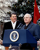 United States President Ronald Reagan, left, looks on as General Secretary of the Communist Party of the Soviet Union Mikhail Sergeyevich Gorbachev, right, makes remarks during the State Arrival Ceremony on the South Lawn of the White House in Washington, D.C. on Tuesday, December 8, 1987..Mandatory Credit: Jerome Howard - DoD via CNP