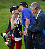 17.10.2014. The London Golf Club, Ash, England. The Volvo World Match Play Golf Championship.  Day 3 group stage matches. Patrick Reed [USA] gets a kiss from his wife Justine after his win over Jamie Donaldson (WAL).