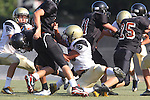 Beverly Hills, CA 09/23/11 - Justin Jimena (Peninsula #79) and unknown Beverly Hills player(s) in action during the Peninsula-Beverly Hills frosh football game at Beverly Hills High School.