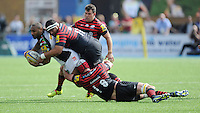 Jordan Turner-Hall of Harlequins is tackled by James Johnston and Alistair Hargreaves of Saracens during the Aviva Premiership semi final match between Saracens and Harlequins at Allianz Park on Saturday 17th May 2014 (Photo by Rob Munro)