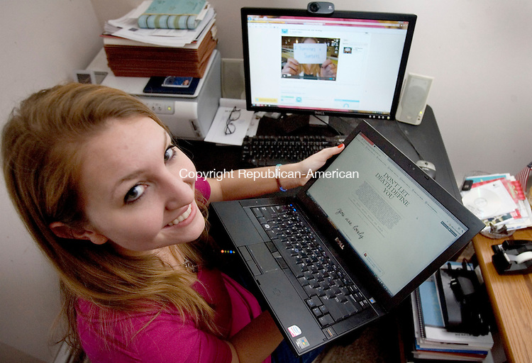 """WATERTOWN, CT. 26 December 2011-122611SV04-Lauren Taylor, 20, of Watertown did a video called """"100 Reasons To Stay"""" for a project at Quinnipiac University then posted it on Vimeo where it has more than 76,000 hits. Taylor works at her home in Watertown Monday. The video was mentioned on the web site Perez Hilton.  Steven Valenti Republican-American"""