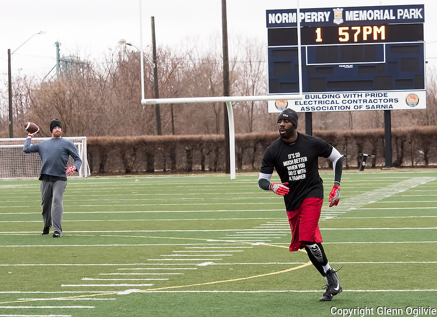 "Between freezing cold and snow and recent rain Sarnia Imperial football players are getting some off season practice in at Norm Perry Memorial Park. Alec Dixon, red shorts, a running back-wide receiver for the Sarnia Imperials and quarterback hopeful Craig Gander were out throwing the pigskin. Gander says the field is the best around. ""I don't have to worry about my footing, it's free of water and they leave the field open for us to practice,"" he said."