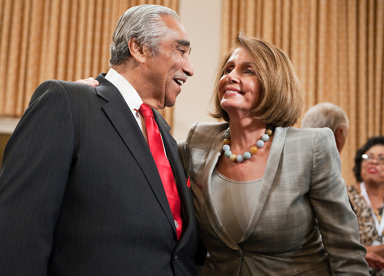 UNITED STATES - SEPTEMBER 22:  Rep. Charlie Rangel, D-N.Y., greets House Minority Leader Nancy Pelosi, D-Calif., in the House Ways and Means Committee hearing room in Longworth Building during a ceremony to unveil Rangel's portrait.  Rangel was chairman of the Committee from 2007-2010.  (Photo By Tom Williams/Roll Call)