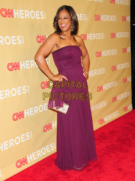 LAILA ALI .at The 3rd Annual CNN Heroes: An All-Star Tribute held at The Kodak Theatre in Hollywood, California, USA,  November 21st 2009                                                                   .full length strapless purple dress long maxi hands on hips gold bag .CAP/RKE/DVS.©DVS/RockinExposures/Capital Pictures