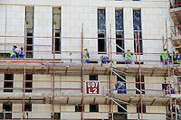 QATAR, Doha, Musheireb, construction boom for FIFA football world cup 2022 , the construction is done by migrant workers from all over the world / KATAR, Doha, Bauboom fuer die FIFA Fußball WM 2022/ KATAR, Doha, Bauboom fuer die FIFA Fußball WM 2022, Abrissviertel Musheireb, auf den Baustellen fuer Neubauten schuften Gastarbeiter aus aller Welt