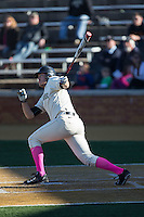 Will Craig (22) of the Wake Forest Demon Deacons follows through on his swing against the Virginia Tech Hokies at Wake Forest Baseball Park on March 7, 2015 in Winston-Salem, North Carolina.  The Hokies defeated the Demon Deacons 12-7 in game one of a double-header.   (Brian Westerholt/Four Seam Images)