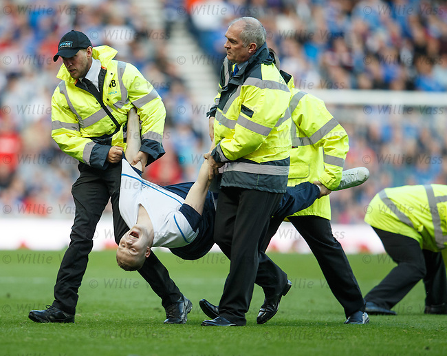 Drunk pitch invader is carried off