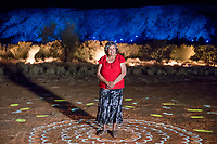 Parrtjima, a festival in Light, Alice Springs, Australia 2017. Pictured is local artist Patricia Ansell Dodds with her artwork from the installation Grounded. September 21, 2017. James Horan Photography for Tourism NT