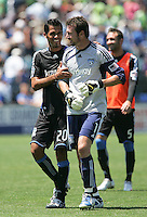Ramon Sanchez (20) and Joe Cannon (10) smile as they walk off the field at half time. The San Jose Earthquakes defeated Seattle Sounders FC 4-0 at Buck Shaw Stadium in Santa Clara, California on August 2, 2009.