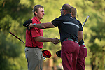 SUGAR GROVE, IL - MAY 29: Mason Overstreet and Head Coach Brad McMakin of the University of Arkansas congratulate Braden Thornberry of Ole Miss on his victory following the Division I Men's Golf Individual Championship held at Rich Harvest Farms on May 29, 2017 in Sugar Grove, Illinois. (Photo by Jamie Schwaberow/NCAA Photos via Getty Images)
