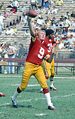 Washington Redskins quarterback Sonny Jurgensen (9) warms-up prior to the game against the Miami Dolphins at RFK Stadium in Washington, DC on October 13, 1974.  The Redskins won the game 20 - 17.<br /> Credit: Arnie Sachs / CNP