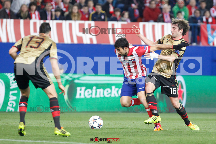 Atletico de Madrid´s Diego Costa (C) and Milan´s Andrea Poli during 16th Champions League soccer match at Vicente Calderon stadium in Madrid, Spain. March 11, 2014. (ALTERPHOTOS/Victor Blanco)