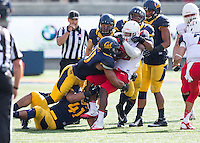 Saturday, November 2nd, 2013: California's Khairi Fortt brings down Arizona's Ka'Deem Carey during a game at Memorial Stadium, Berkeley, Final Score: Arizona defeated California 33-28