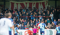 Opposition supporters sit together beneath a banner saying 'Unity' during the pre season friendly match between Aldershot Town and Wycombe Wanderers at the EBB Stadium, Aldershot, England on 22 July 2017. Photo by Andy Rowland.