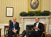 United States President Barack Obama (R) makes remarks as Prime Minister Enrico Letta of Italy listens after a bilateral meeting in the Oval Office of the White House, in Washington, DC, USA, 17 October 2013. The two leaders discussed economic relations as well as military ties and US-Euro issues.<br /> Credit: Mike Theiler / Pool via CNP