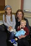 Guiding Light's Mandy Bruno celebrates her son Flynn Bogue's second birthday in January. In the photo also is Zoe Bogue, daughter of Robert Bogue. (Photo by Sue Coflin/Max Photos)