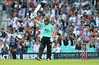Aaron Finch raises his bat to celebrate reaching his fifty for Surrey during Surrey vs Essex Eagles, Vitality Blast T20 Cricket at the Kia Oval on 12th July 2018