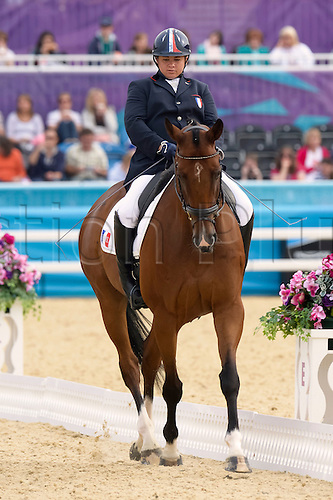 01.09.2012 London, England Valerie Salles of France and Menzana D'Hulm  in action  during women's  dressage individual championships Grade ib  on Day 3 of the London Paralympics Games Equestrian from the greenwich park .