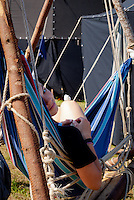 A scout from German VCP troop is relaxing in a hammock in summer village. Photo: André Jörg/ Scouterna