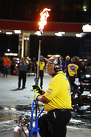 Jun 19, 2015; Bristol, TN, USA; NHRA A member of the Safety Safari holds a blow torch during qualifying for the Thunder Valley Nationals at Bristol Dragway. Mandatory Credit: Mark J. Rebilas-