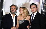 "WESTWOOD, CA. - December 15: Director Sam Mendes, Actress Kate Winslet and Actor Leonardo DiCaprio arrive at the Los Angeles premiere of ""Revolutionary Road"" held at the Mann Village Theater on December 15, 2008 in Westwood, California."