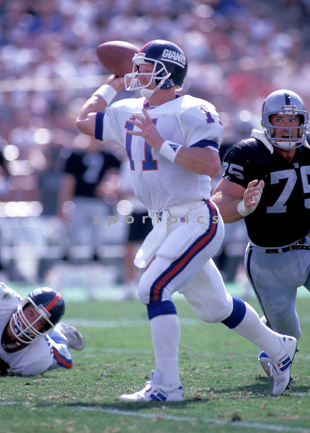 New York Giants Phil Simms (11) in action during a game against the Los Angeles Raiders on October 4, 1992 at Los Angeles Memorial Coliseum in Los Angeles, California. The Raiders beat the Giants 13-10.