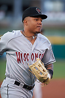 Wisconsin Timber Rattlers left fielder Leugim Castillo (27) jogs off the field between innings of a Midwest League game against the Lansing Lugnuts at Cooley Law School Stadium on May 1, 2019 in Lansing, Michigan. Wisconsin defeated Lansing 2-1 in the second game of a doubleheader. (Zachary Lucy/Four Seam Images)