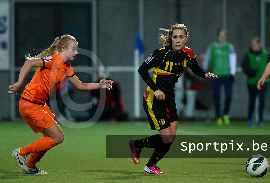20140212 - ZWOLLE , THE NETHERLANDS : Belgian Janice Cayman (r) pictured with Dutch Kika Van Es (l) during the female soccer match between The Netherlands and Belgium , on the fifth matchday in group 5 of the UEFA qualifying round to the FIFA Women World Cup in Canada 2015 at Het Ijseldelta Stadion , Zwolle . Wednesday 12th February 2014 . PHOTO DAVID CATRY