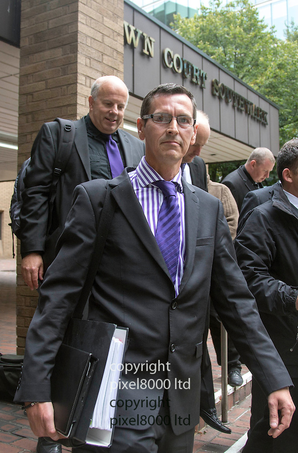Pic shows: Tim Harries  - glasses - purple tie - after appearing at Southwark Crown Court today. 17.9.13<br /> <br /> A Fathers4Justice campaigner appeared in court today accused of defacing a portrait of the Queen in Westminster Abbey.<br /> <br /> Tim Haries, 41, is alleged to have smuggled a can of spray paint into the abbey yesterday before defacing the picture.<br /> <br /> He appeared at Court charged with criminal damage of more than £5,000.<br /> <br /> <br /> <br /> <br /> Pic by Gavin Rodgers/Pixel 8000 Ltd