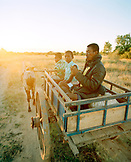 MADAGASCAR, family traveling in ox cart, Beza Mahafaly Tribe