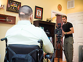 Afganistan war vet Josh Himan during filing of a video segment at his family's home in Woodbridge, VA.