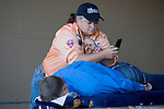 Masseuse Jeanine Hurst answer a text message while giving Heath Ford, a World Champion Bareback Rider,  from Slocum, TX,  a massage before the Bareback Riding event  at the Kitsap County Fair and Stampede held Aug. 22 to Aug. 26, 2012 in Silverdale, WA. ©2012. Jim Bryant Photo. All Rights Reserved