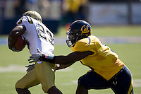 September 4, 2010: D.J. Holt of California tries to tackle Jonathan Franklin of UCLA during a game at Memorial Stadium in Berkeley, California.    California defeated UCLA 35-7
