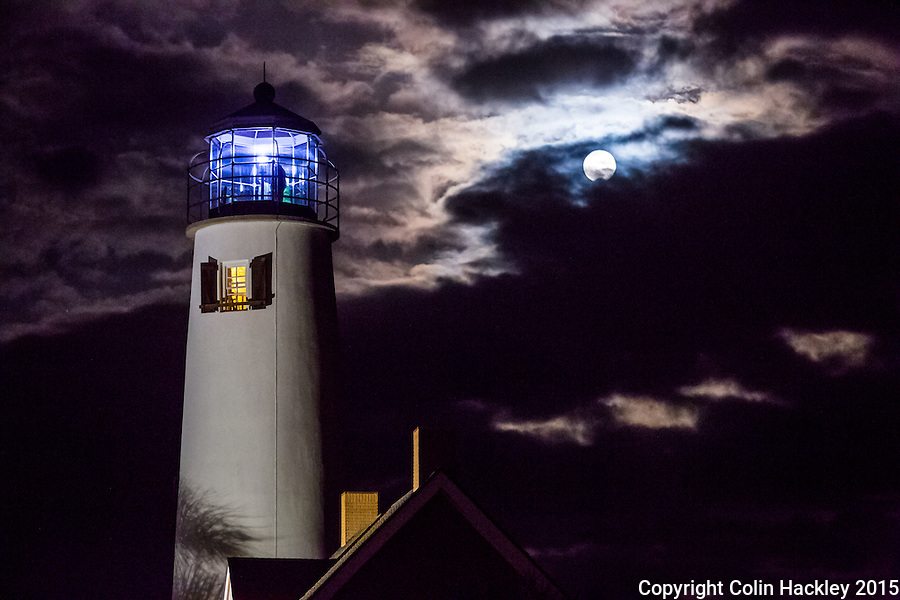 St. GEORGE ISLAND, FLA., 11/25/15-Visitors to the lighthouse on St. George Island, Fla. watch the full moon rise. The lighthouse offers special tours every month on the day that the sunset and full moon rise coincide. <br /> <br /> COLIN HACKLEY PHOTO