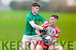 Shane Bastible of Mounthawk tackles Sean O' Laoite of Pobail Corca Dhuibhne in the Frewen Cup qtr final on Thursday.