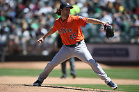OAKLAND, CA - MAY 9:  Gerrit Cole #45 of the Houston Astros pitches against the Oakland Athletics during the game at the Oakland Coliseum on Wednesday, May 9, 2018 in Oakland, California. (Photo by Brad Mangin)