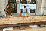 Japanese actress and singer Hikari Mitsushima (C) uses a stone axe to construct a wooden dugout canoe during a news conference at the National Museum of Nature and Science in Tokyo on July 31, 2018, Tokyo, Japan. The museum aims to collect 30 million yen to recreate the Japanese ancestors' journey between Taiwan and Yonaguni Island on a wooden dugout canoe. (Photo by Rodrigo Reyes Marin/AFLO)