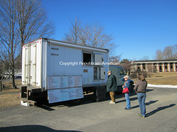 WOODBURY, CT - 9 Feb 2012 - 020912RH02 - Customers line up for service at a seafood truck on Main Street South in Woodbury. The Board of Selectman has called for the Zoning Commission to issue a one-year moritorium on permits for vendor trucks in town. Rick Harrison Republican-American