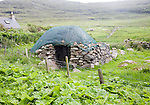 Stone roundhouse structure used as croft storage Isle of Barra, Outer Hebrides, Scotland, UK