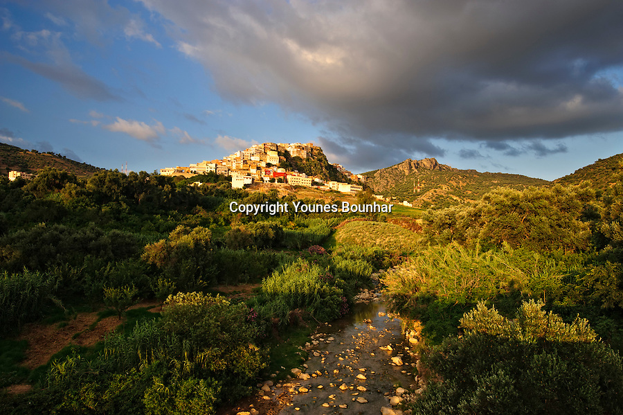 Golden evening light bathing the village of Moulay Idriss Zerhoun the founding village of modern Morocco