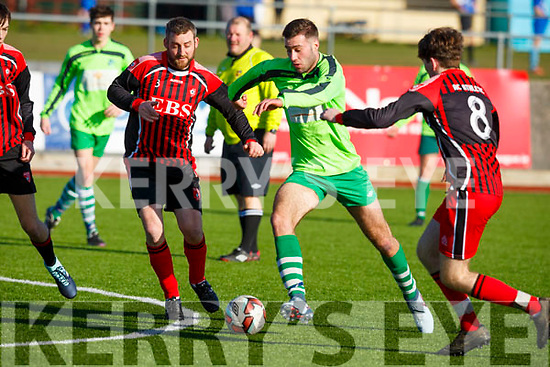 Joseph Diggins of AC Athletic keeps his eye on the ball as he tests the Killarney Celtic defence in their game in Mounthawk Park on Sunday last