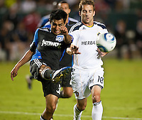CARSON, CA – August 20, 2011: San Jose Earthquake midfielder Rafael Baca (30) and LA Galaxy forward Mike Magee (18) during the match between LA Galaxy and San Jose Earthquakes at the Home Depot Center in Carson, California. Final score LA Galaxy 2, San Jose Earthquakes 0.