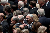Former Secretary of State Colin Powell, center right, speaks to a guest before a State Funeral for former President George H.W. Bush at the National Cathedral, Wednesday, Dec. 5, 2018,  in Washington.<br /> Credit: Andrew Harnik / Pool via CNP