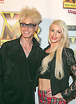 Magician/comedian Murray SawChuck and entertainer Chloe Louise Crawford arrive at the Vegas Rocks Magazine Music Awards 2013 at the Joint inside the Hard Rock Hotel & Casino in Las Vegas, Nevada.
